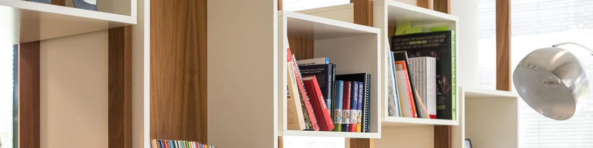 Bookshelves Photo byArlington ResearchonUnsplash