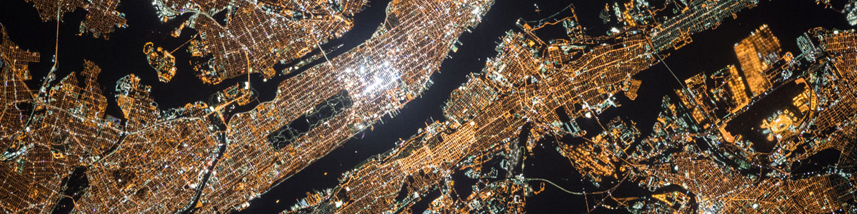 Satellite image of lights in a big city Photo by NASA on Unsplash